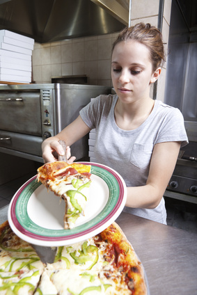 Waitress serving a slice of all dressed pizza
