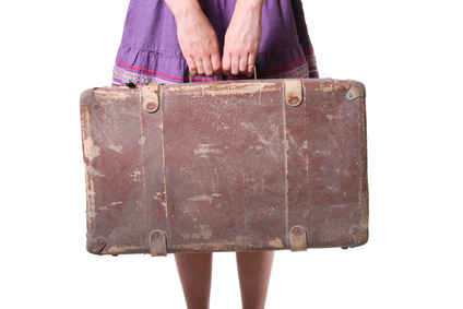 Woman hold old suitcase